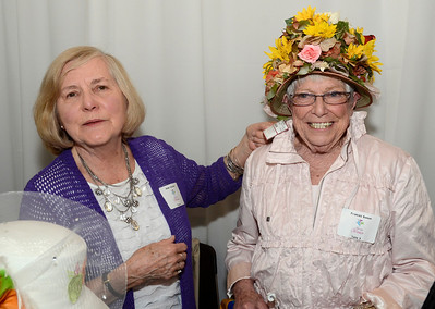 Ed Burke - The Saratogian 04/24/14 Anne Hunscher tries to interest Fran Barron in a spring hat from the collection at Treasures where they both volunteer for the Saratoga Hospital Foundation. The two helped out at their table during Thursday's Just for Women event.