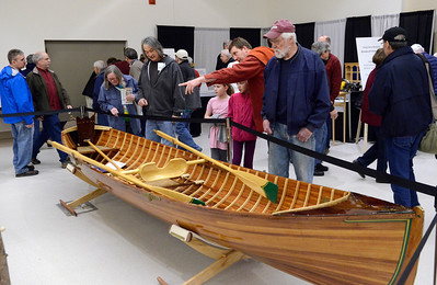 Ed Burke - The Saratogian 03/29/14 Visitors to the Northeast Woodworkers Association's Showcase at the Saratoga Springs City Center admire handmade boats including this Adirondack guideboat. The show continues Sunday.