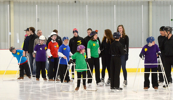 Ed Burke - The Saratogian 03/29/14 Stars and volunteers take to the ice during the Saratoga Ice Stars program Saturday at Saratoga Springs Ice Rink. The program, which is over 15 years old, is run by the Saratoga Springs Lions Club and gets physically challenged youths and adults on the ice to enjoy skating.