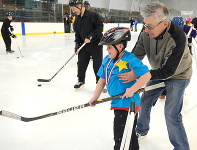 Ed Burke - The Saratogian 03/29/14 Seven year old Joe Anderson of Greenfield gets some help from lions Club member Grady Arostamm during the Saratoga Ice Stars program Saturday at Saratoga Springs Ice Rink. The program, which is over 15 years old, is run by the Saratoga Springs Lions Club and gets physically challenged youths and adults on the ice to enjoy skating.