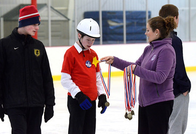 Ed Burke - The Saratogian 03/29/14 Thirteen year old William Richmond of Hudson Falls gets a medal from volunteer Margaret D'Andrea during the Saratoga Ice Stars program Saturday at Saratoga Springs Ice Rink. The program, which is over 15 years old, is run by the Saratoga Springs Lions Club and gets physically challenged youths and adults on the ice to enjoy skating.