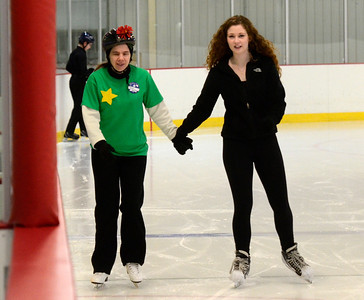 Ed Burke - The Saratogian 03/29/14 Skating together for the past nine years, Amy LaPriarie, left, skates with volunteer helper Zoe Shannon during the Saratoga Ice Stars program Saturday at Saratoga Springs Ice Rink. The program, which is over 15 years old, is run by the Saratoga Springs Lions Club and gets physically challenged youths and adults on the ice to enjoy skating.