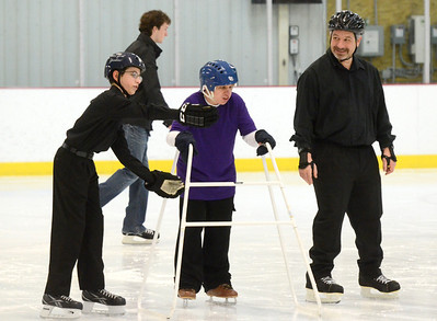 Ed Burke - The Saratogian 03/29/14 Ben Thomas of Ballston Spa is assisted by Connor Roizman of Guilderland as Connor's father Mike looks on during the Saratoga Ice Stars program Saturday at Saratoga Springs Ice Rink. The program, which is over 15 years old, is run by the Saratoga Springs Lions Club and gets physically challenged youths and adults on the ice to enjoy skating.