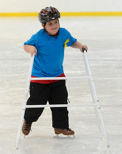 Ed Burke - The Saratogian 03/29/14 Seven year old Joe Anderson of Greenfield skates during the Saratoga Ice Stars program Saturday at Saratoga Springs Ice Rink. The program, which is over 15 years old, is run by the Saratoga Springs Lions Club and gets physically challenged youths and adults on the ice to enjoy skating.