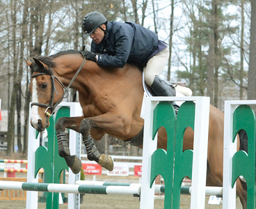 Ed Burke - The Saratogian 04/30/14 Richard Hoffend of Honeoye Falls jumps his mount Thurston during opening day of the Saratoga Springs Horse Show on Union Ave.