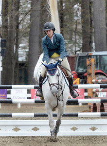 Ed Burke - The Saratogian 04/30/14 Flipping a tall tail, Casstess HBC carries rider Addison Gierkink over a fence during opening day of the Saratoga Springs Horse Show.