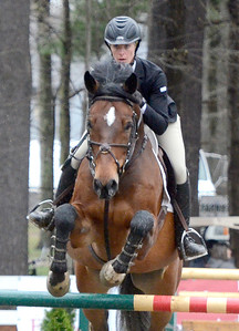 Ed Burke - The Saratogian 04/30/14 Hillary Rheinheimer of East Hampton, Connecticut jumps Corton during opening day of the Saratoga Springs Horse Show.