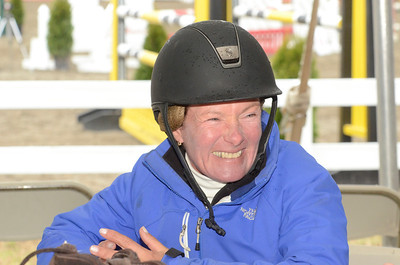 Ed Burke - The Saratogian 04/30/14 Kristi Smith of Madison, Connecticut takes a break between rides during the opening day of the Saratoga Springs Horse Show.