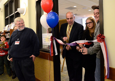 Ed Burke - The Saratogian 04/05/14 Fifteen year olds Sydney Smith and Austin Roggen get help from Saratoga Springs School Superintendent Michael Picirillo as they cut the ribbon Saturday officially opening the renovated teen room at Saratoga Springs Public Library. Library Director A. Issac pulver looks on at left.