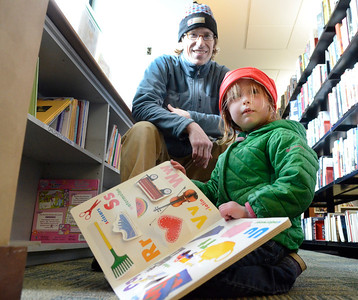 Ed Burke - The Saratogian 04/05/14 Anna Yarsevich of Saratoga Springs and her father Chris visit the Book Bag Shop Saturday during the grand opening of the renovated used book store at the Saratoga Springs Public Library.