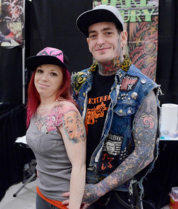 Ed Burke - The Saratogian 04/05/14 Artist Jake Noury and Courtney Rojek attend Saturday's Saratoga Tattoo Expo at the Saratoga Springs City Center.