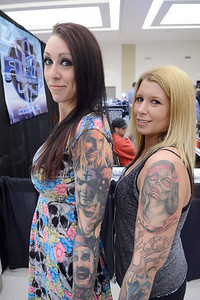 Ed Burke - The Saratogian 04/05/14 Lynnette Bourdon, left, and Andrea Nicholson, both of Glens Falls, show off their ink Saturday at the Saratoga Tattoo Expo at the city center.