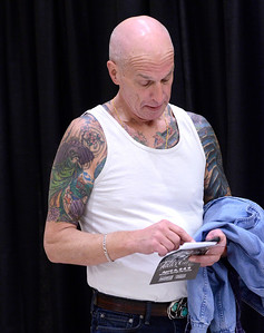 Ed Burke - The Saratogian 04/05/14 Scott Walter of Oneida sends a text message while attending the Saratoga Tattoo Expo at the city center.