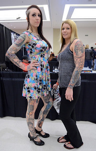 Ed Burke - The Saratogian 04/05/14 Lynnette Bourdon, left, and Andrea Nicholson of Glens Falls show off their ink Saturday at the Saratoga Tattoo Expo at the city center.