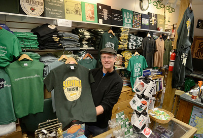 Ed Burke - The Saratogian 03/13/1 Owner Paul O'Donnell of Celtic Treasures on Broadway displays one of many shirts they sell which would be appropriate attire for St. Patrick's Day.