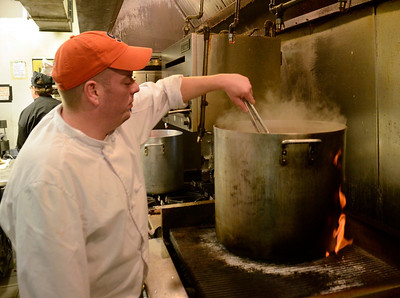 Flames lick the side of the pot as chef Todd Cutler of the Irish Times restaurant prepares corned beef for the St. Patrick's Day weekend.