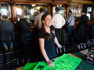 Ed Burke - The Saratogian 03/13/14 Barmaid Alyssa Rose at The Parting Glass stands with signs being made for the busy St. Patrick's Day weekend which coincides with the pub's 33rd anniversary.