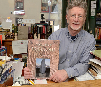 Ed Burke - The Saratogian 03/13/14 John DeMarco of Lyrical Ballad Bookstore on Phila St. holds one of the many Irish and Celtic-themed books he has for sale.