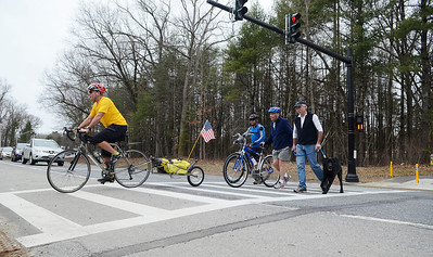 Erica Miller @togianphotog - The Saratogian:  On Friday afternoon, April 11th, 2014, in Saratoga Springs Dan Lynch (front on bike), Pete Goutos (with dog Junior), Wally Elton (center) and Jeff  Olson cross the newest crosswalk at Railroad Run Trail to the Spa Park trails.