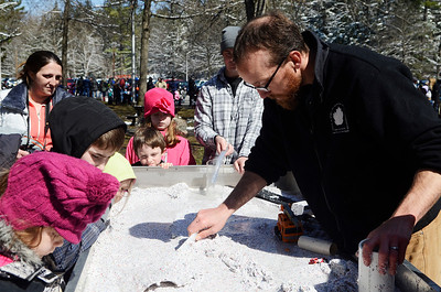 Erica Miller @togianphotog - The Saratogian:  On Wednesday morning, April 16th 2014, the hundreds lined-up the Van Hornesville Fish Hatchery, operated by the Department of Environmental Conservation, stocked the Geyser Creek with trouts at the Saratoga Spa State Park. Casey Holzworth demonstrated to children how water flows with the movement of cars and homes.