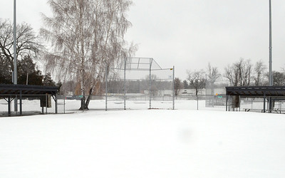 Ed Burke - The Saratogian 03/12/14 The view from second base doesn't look too promising at the softball field at Veterans Memorial Park, home to the Saratoga Central Catholic Lady Saints.