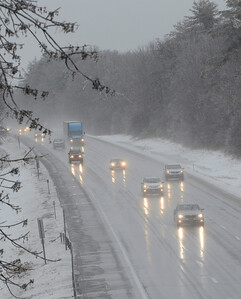 Ed Burke 03/12/14 Motorists head north through rain and sleet Wednesday on the Northway.