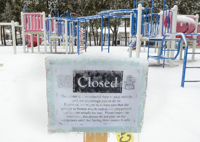 Ed Burke - The Saratogian 03/12/14 Snow-covered from Wednesday's storm, playground equipment waits for warmer weather at East Side Rec Park.