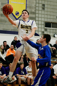 Erica Miller - The Saratogian @togianphotog      The Saratoga Central Catholic Saint's Luke Spicer takes a shot with the ball during their basketball game against Mayfield on Monday evening on January 13th, 2014.