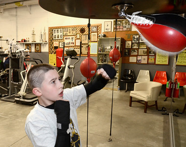 Ed Burke - The Saratogian 01/22/14 Ten year old Shawn Rivers of Fort Edward hits a speed bag Wednesday evening at Saratoga Youth Boxing Association's gym ar Saratoga Springs Ice Rink.