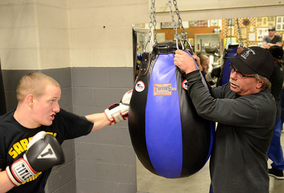 Ed Burke - The Saratogian 01/22/14 Saratoga Youth Boxing Association's Mike Nichols holds the bag during a workout by sixteen year old Lucas LaPlanche of Saratoga Springs.
