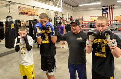 Ed Burke - The Saratogian 01/22/14 Saratoga Youth Boxing Association's Mike Nichols with boxers, from left: ten year old Shawn Rivers of Fort Edward, fifteen year old Dorsett Varnado and Lucas LaPlanche, age sixteen of Saratoga Springs.