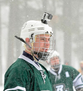 Ed Burke - The Saratogian 01/25/14 Playing for team Beercat University, Joe Livsey of Buffalo wears a video camera on his helmet Saturday during the Saratoga Frozen Springs Classic Hockey Tournament at Saratoga Spa State Park.
