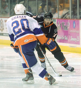 Ed Burke - The Saratogian 04/18/14 Adirondack's Derek Whitmore is challenged by Bridgeport's Jesse Graham during the Phantom's last game in Glens Falls Friday evening.