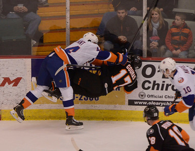 Ed Burke - The Saratogian 04/18/14 Bridgeport's Brett Gallant takes out Adirondack's Kevin Goumas during Friday's game in Glens Falls. The game was the last Phantom's game at the Civic Center