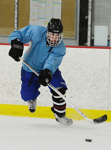 Erica Miller @togianphoto - The Saratogian, The Rivermen Ice Hockey team practiced on Monday, Jan. 13th, 2014, afternoon at the Glens Falls Rec Center. Teammate Logan Akins during practice as they get ready for their next game. The team consists students from South Glens Falls, Glens Falls and Hudson Falls.