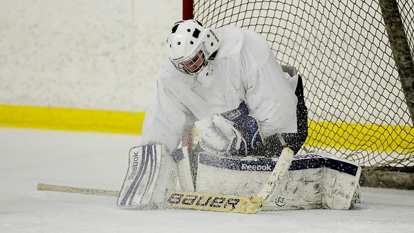 Erica Miller @togianphoto - The Saratogian, The Rivermen Ice Hockey team practiced on Monday, Jan. 13th, 2014, afternoon at the Glens Falls Rec Center. Goalie Joe Lovering during practice as they get ready for their next game. The team consists students from South Glens Falls, Glens Falls and Hudson Falls.
