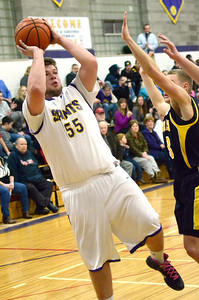 Ed Burke - The Saratogian 01/17/14 Saratoga Central Catholic's Keegan Murphy takes aim during Friday's varsity basketball matchup against Canajoharie in Saratoga.