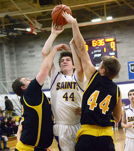 Ed Burke - The Saratogian 01/17/14 Saratoga Central Catholic's Mike Naughton runs into defense by Canajoharie's Josh Gonzalez and  Zach Ouderkirk during Friday's varsity basketball matchup in Saratoga.