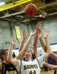 Ed Burke - The Saratogian 01/17/14 Saratoga Central Catholic's Mike Naughton hopes for the best on a heavily contested rebound during Friday's varsity basketball matchup against Canajoharie in Saratoga.