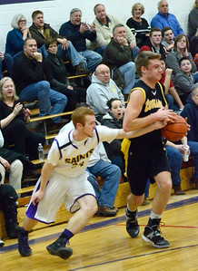 Ed Burke - The Saratogian 01/17/14 Saratoga Central Catholic's JR Hmura looks for a steal as Canjo's Josh Gonzalez guards the ball during Friday's varsity basketball matchup in Saratoga.