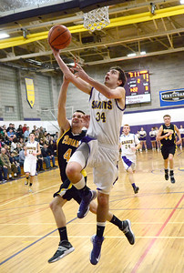 Ed Burke - The Saratogian 01/17/14 Saratoga Central Catholic's Evan Pescetti goes up for  as Canajoharie's Colin Davis tries to block during Friday's varsity basketball matchup in Saratoga.