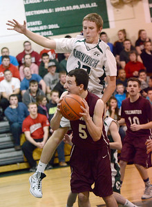 Ed Burke - The Saratogian 01/21/14 Greenwich's John Stewart goes up to block Stillwater's Parker MacMurray during Tuesday's matchup at Greenwich. Mac Murray was fouled on the attempt which sank for two and converted the free throw for a three point play.