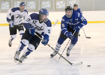 Ed Burke - The Saratogian 01/22/14 Saratoga's Grayson Rieder advances the puck pursued by La Salle's Ben Mulson during Wednesday's game in Saratoga. Rieder scored for the Blue Streaks on a slapshot during the first period play.