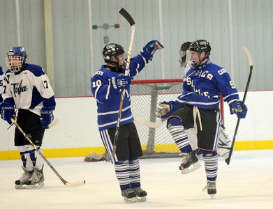 Ed Burke - The Saratogian 01/22/14  La Salle's Joe O'Bryan (9) and Jonathan Dow celebrate after O'Bryan's score against Saratoga Wednesday at Saratoga.