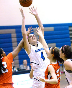 Ed Burke - The Saratogian 01/23/14 Saratoga's Amanda Flemming forces a shot despite pressure by Mohonasen's Saeeda Abdul-Aziz, left, and Grace Wyanski during Thursday's game at Saratoga.