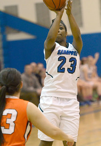 Ed Burke - The Saratogian 01/23/14 Saratoga's Dominique Managault takes a jumper over Mohonasen during Thursday's girls' varsity basketball matchup at Saratoga.