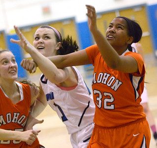Ed Burke - The Saratogian 01/23/14 Saratoga's Maddie Stanley fights for a rebound against Mohonasen's Grace Wyanski, left, and Seeda Abdul-Aziz during Thursday's girls' varsity basketball matchup at Saratoga.