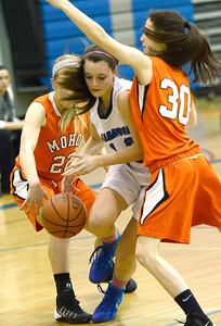 Ed Burke - The Saratogian 01/23/14 Saratoga's Maddie Chudy tries to push through Mohonasen defenders Maddie Egan (22) and Quinn Roderick during Thursday's game at Saratoga.