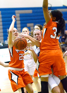 Ed Burke - The Saratogian 01/23/14 Saratoga's Ann Mahoney hits a  Mohonasen traffic jam of Saeeda Abdul-Aziz (32) and Grace Wyanski during Thursday's game at Saratoga.