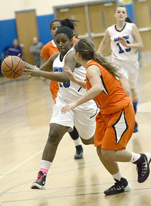 Ed Burke - The Saratogian 01/23/14 Saratoga's Dominique Managault drives toward the basket as Mohonasen's Taylor Piscitella defends during Thursday's girls' varsity basketball matchup at Saratoga.